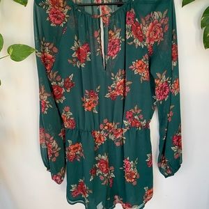 Green, long-sleeved, floral romper.